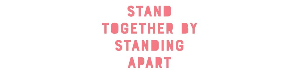 A spraypaint stencil with red lettering reads: Stand together by standing apart
