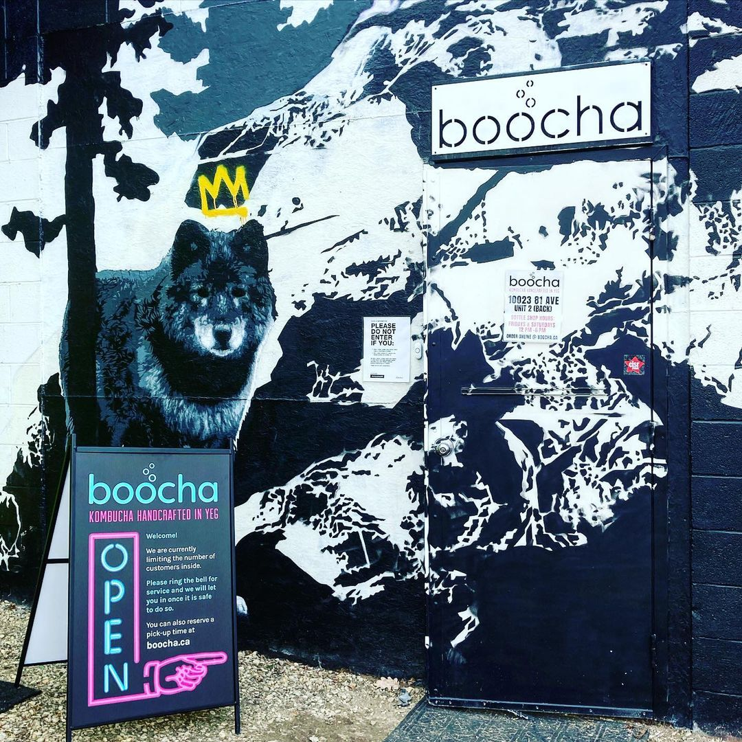 A wolf mural greets customers to Boocha's back alley bottleshop