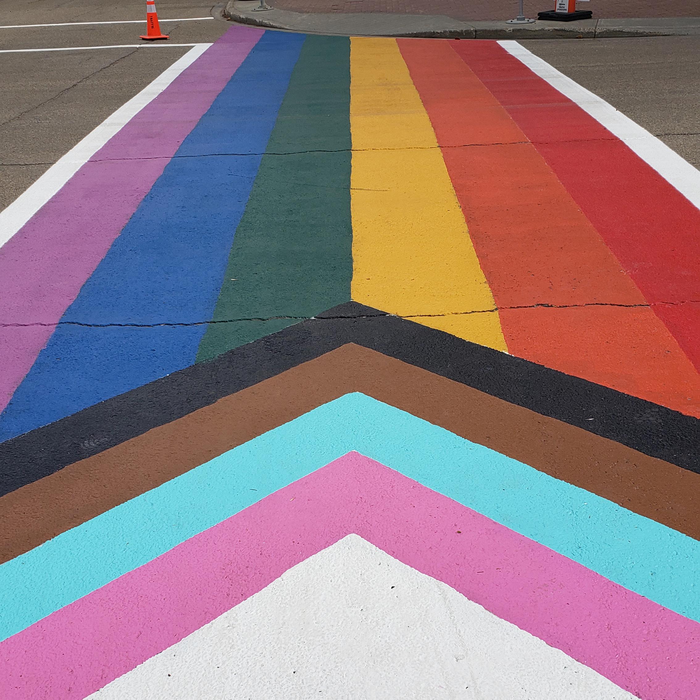Pride Progress flag painted on a crosswalk